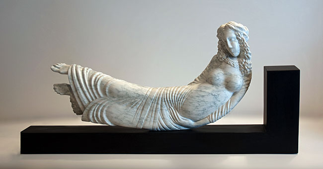 Simon Muscat Goldsmith - <i><span style='text-transform:none;'>This is the bratty Lady</span></i>, Vermont marble, 36in W X 18.5in H X 5.5in D. Wooden base is 41.75in W X 14.5in H X 5.25in D.<br>93cm W X 47cm H X 14cm D. Wooden base is 124cm W X 36.5cm H X 13.5cm D.